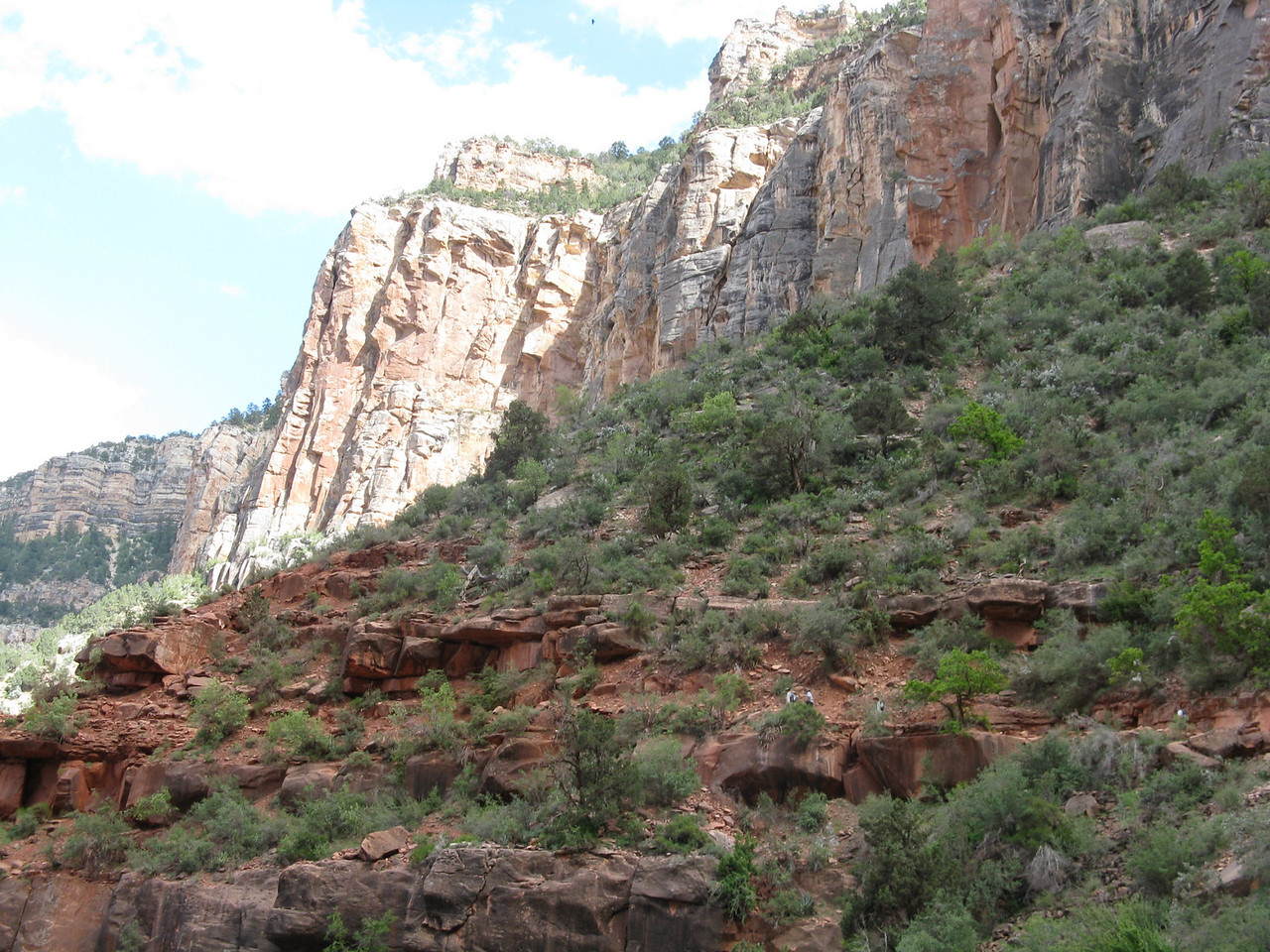 On the lower part of the picture is the trail in the Supai Group of rocks.  Above are the Coconino Sandstone cliffs.  In between these two layers is the Hermit Formation (not well seen).