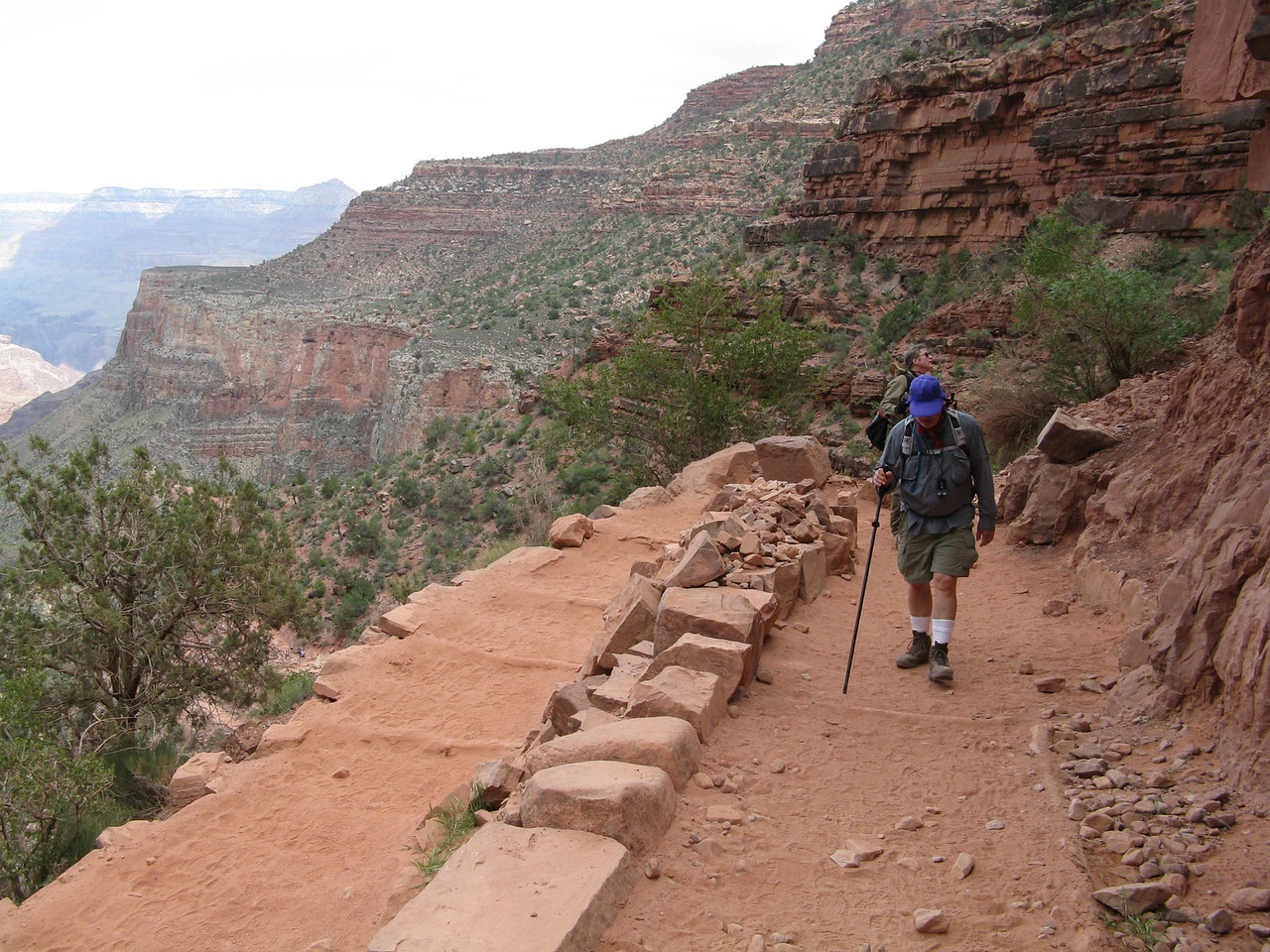 Wendell plodding uphill in the Supai Group of rock layers.