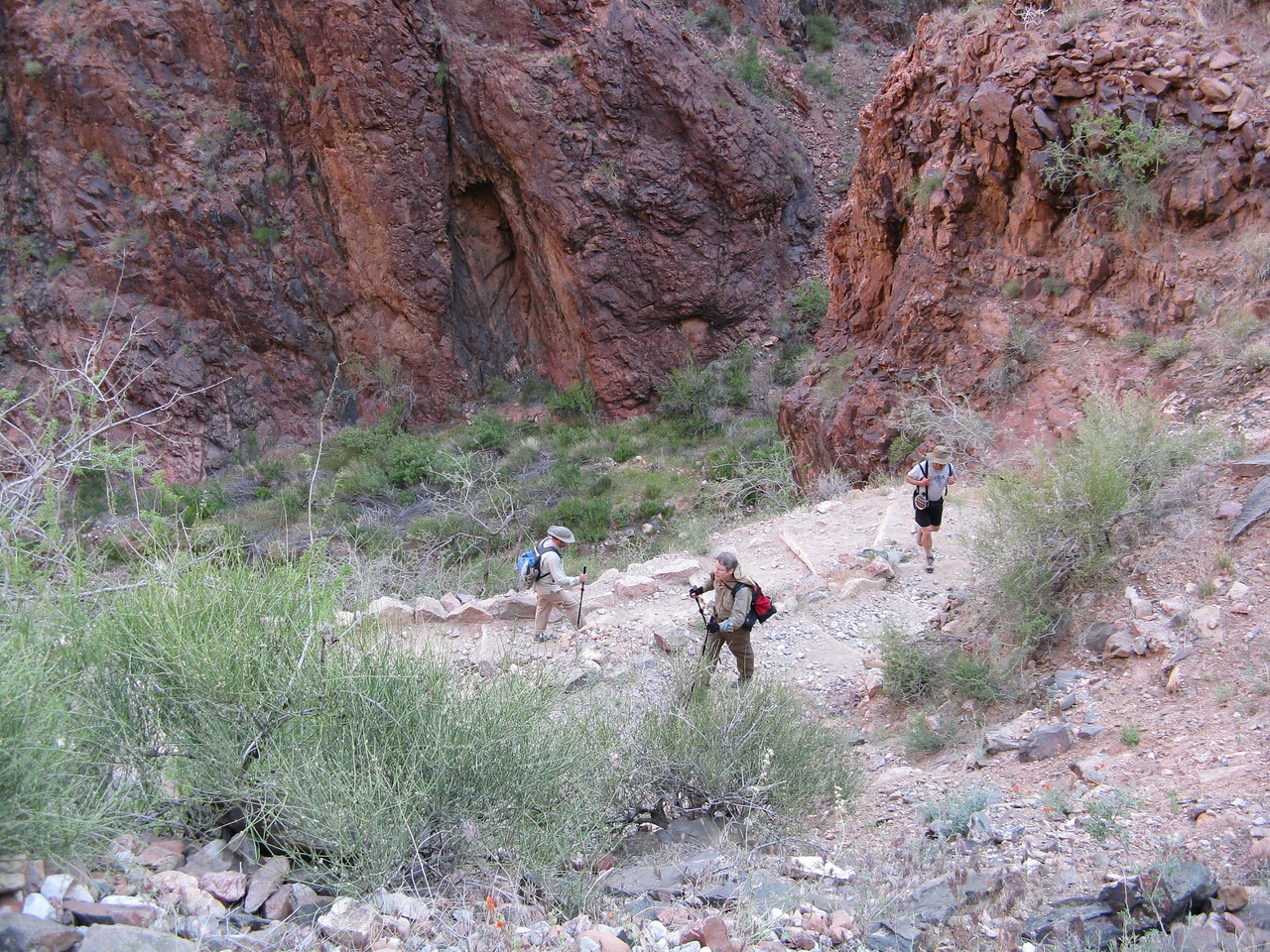 3.6 miles.  The switchbacks up the rocks at the upper end of Pipe Creek canyon are called the Devil's Corkscrew.  Richard, Dariusz behind and Jeff on the lower level.
