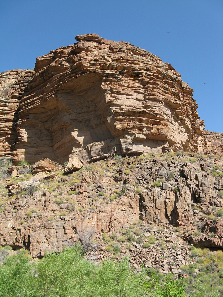 A butte stands above us as we hike up the trail.