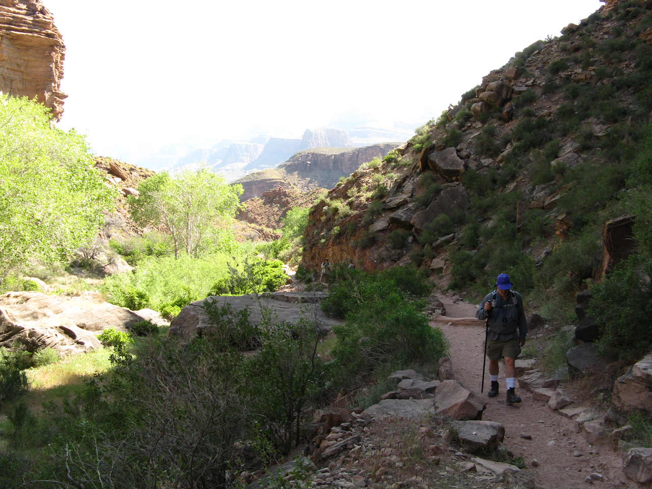 Wendell is hiking on the trail with Garden Creek on the left.  The canyon in the distance is overexposed in this frame.