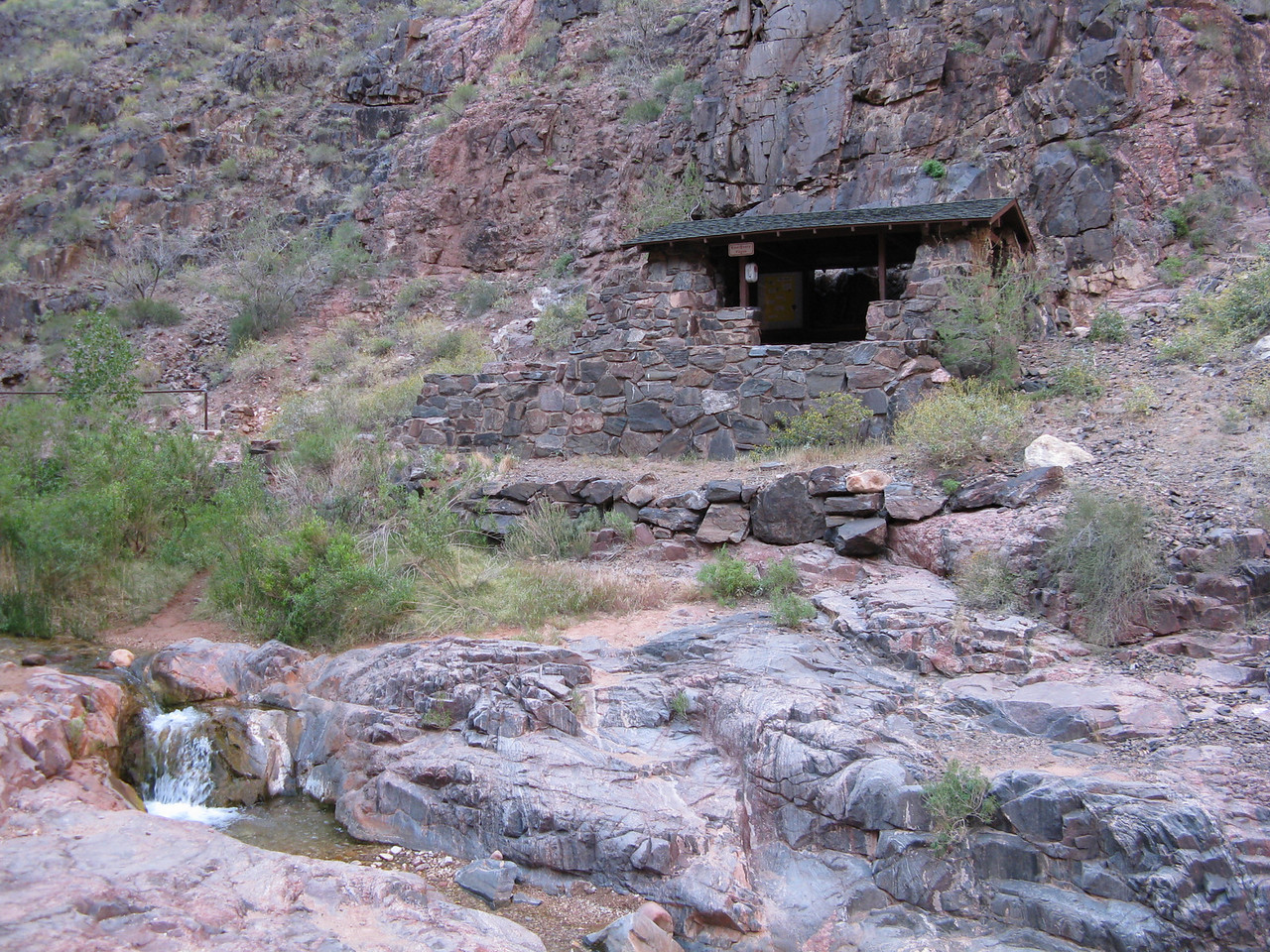 1.9 miles, 2480 feet of elevation, 30 feet of elevation gain.  The River Resthouse provides shade when the sun is high in the sky.  On this early morning, the resthouse itself was shaded by the canyon walls.  Pipe Creek gurgles in the foreground.