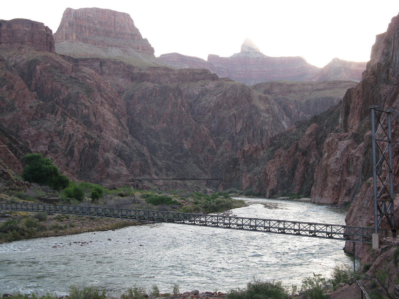 Looking upstream from just beyond the Silver Bridge with the Black Bridge in the distance.  In this early morning picture, there is direct sunlight at the top of the canyon, but it will not reach the bottom of the canyon for some time.