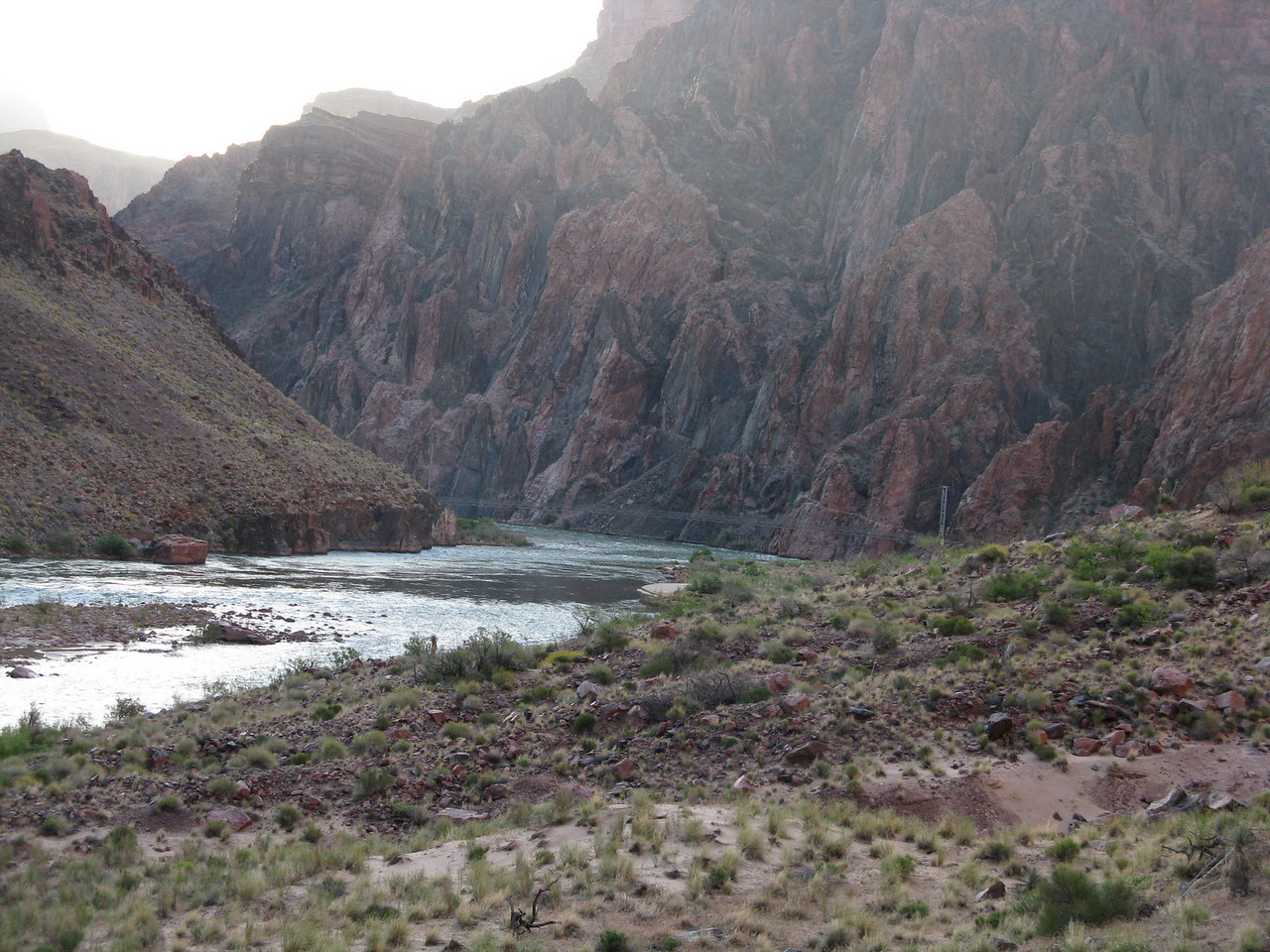 Sun above and shadows in the canyon.  The silver bridge is just a gossamer in this image.
