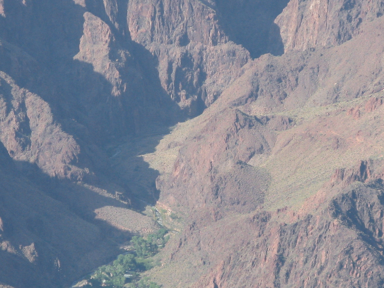 In this telephoto image, Phantom Ranch and Bright Angel Creek can be seen on the north side of the Colorado River.