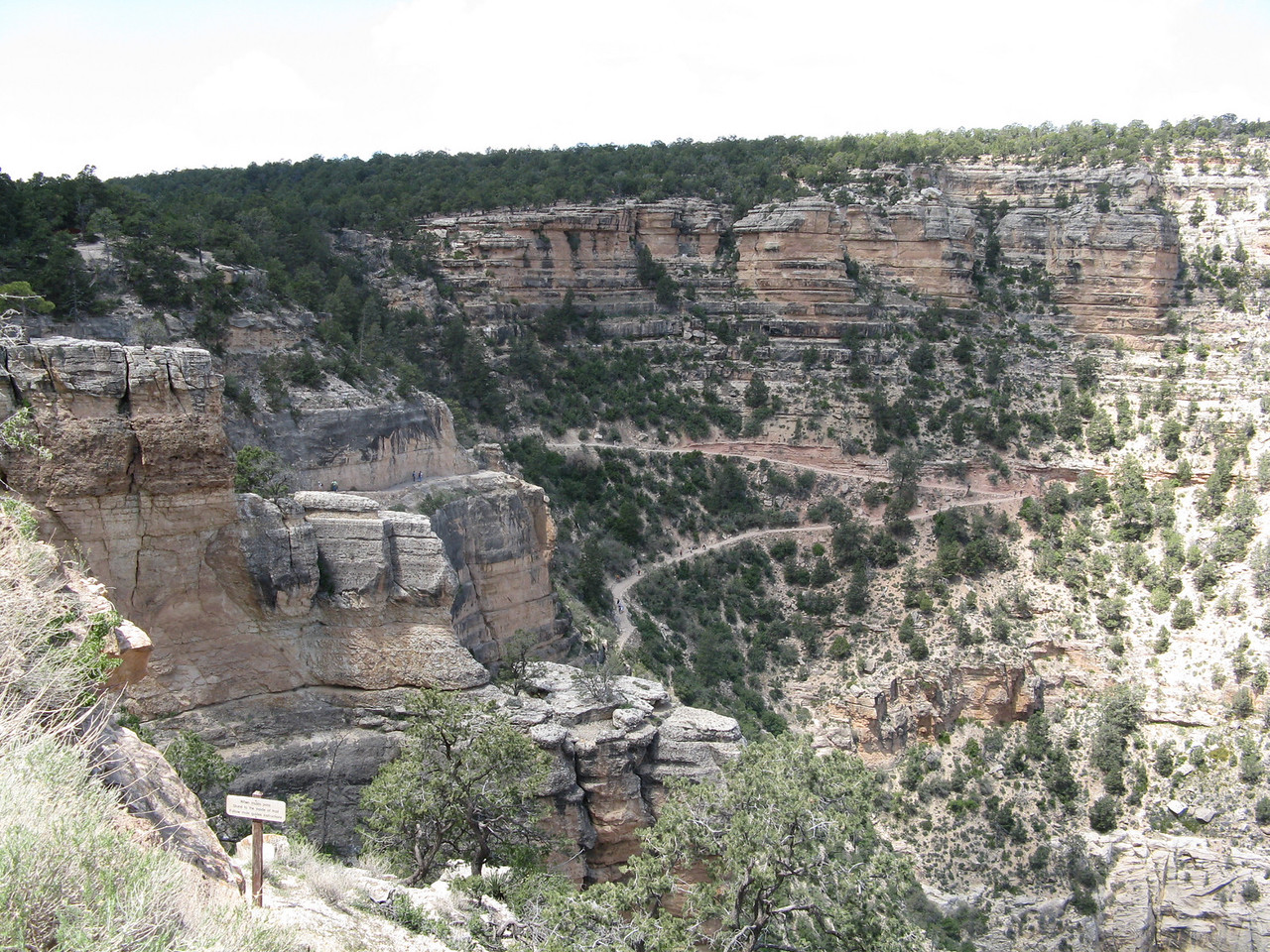 The last long switchback in Bright Angel Trail before it reaches to top of the rim.  The trail comes back to the left side of the picture.