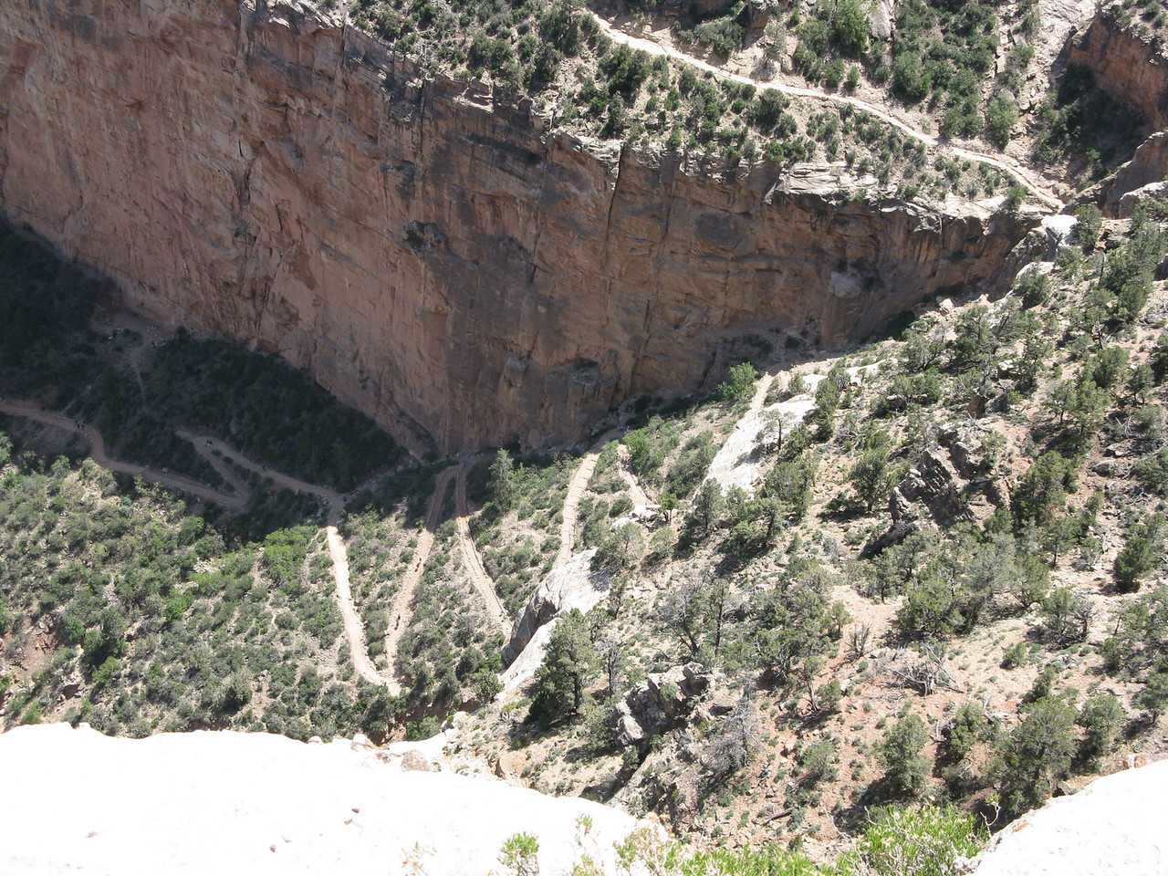 The Bright Angel Trail in the Coconino gap.   The trail zigzags up the slope in the break in the sandstone cliffs.  This occurs about 1 mile below the south rim.  The Second Tunnel is at the top of Coconino gap, but it cannot be seen in this image.