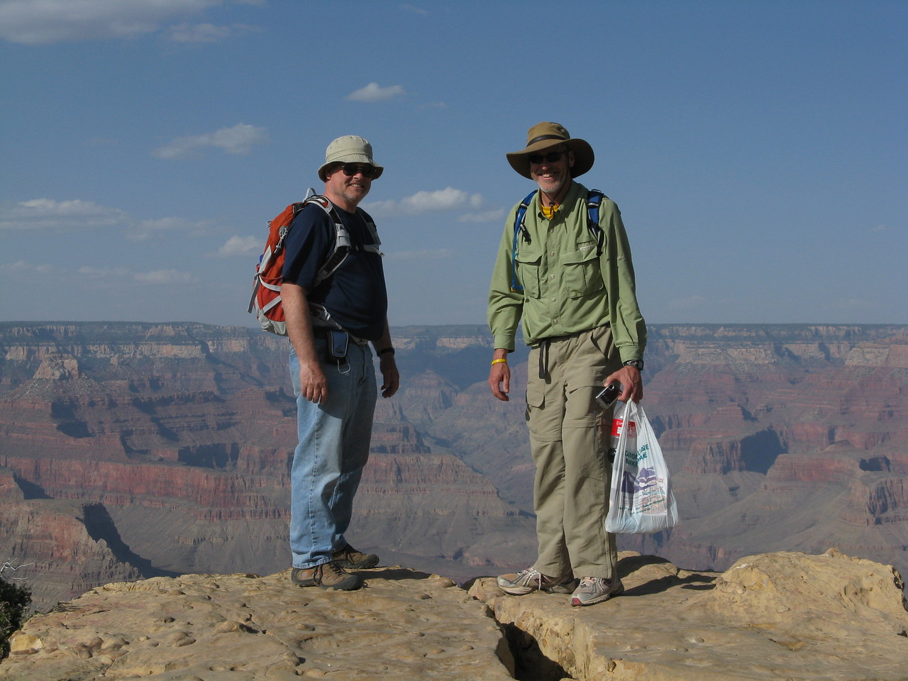 Wendell and Glenn standing very close to the edge of the rim.