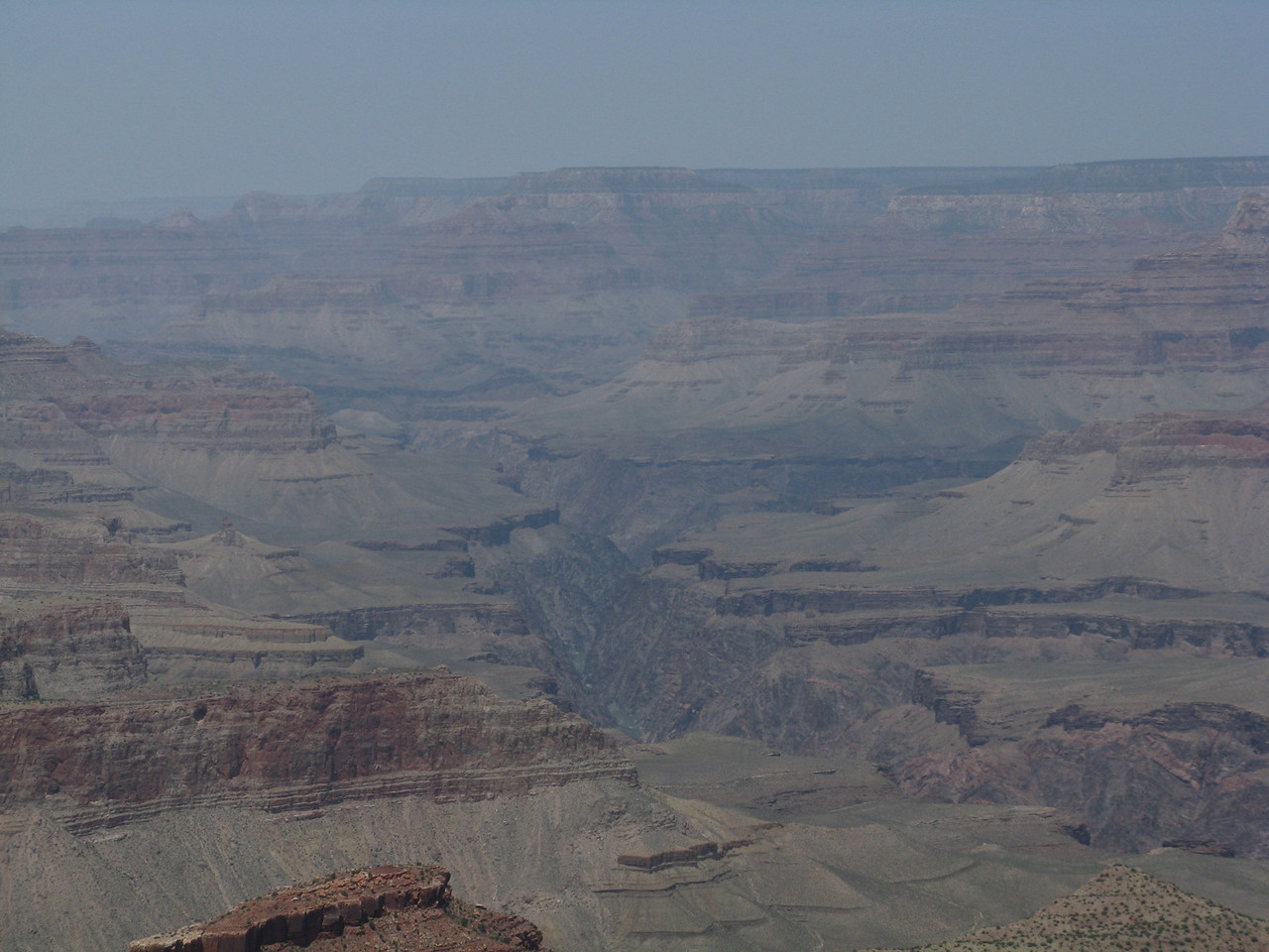 Looking downstream with a glimpse of the bottom of the inner gorge as seen from the rim.