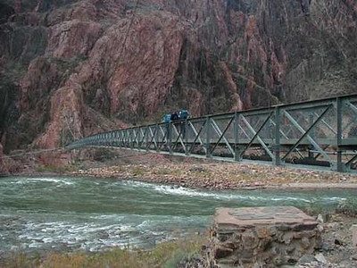 Foot bridge across the Colorado River at the bottom of the Canyon.  <br /> <br /> From Phantom Ranch, we will hike down to and cross the Colorado River, and then traverse nearly flat terrain to the RIver Resthouse for a total of 1.9 miles .
