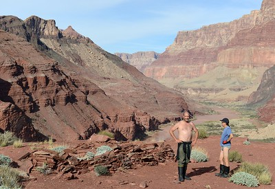 Anasazi ancestral puebloan ancient native American ruins with two partially dressed river runners standing around at mile 68.3