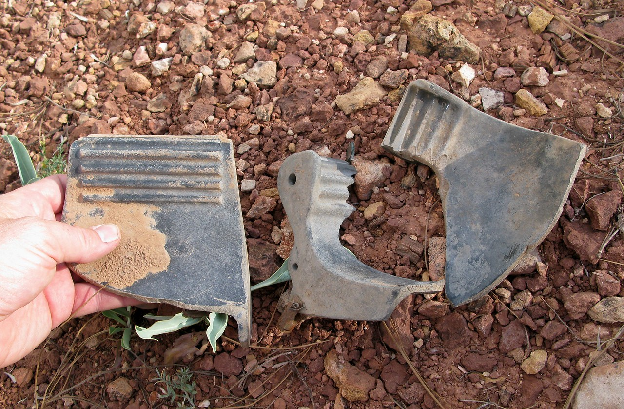 Three fragments of the aircraft rudder pedals again illustrate the severe destructive forces involved in this accident.