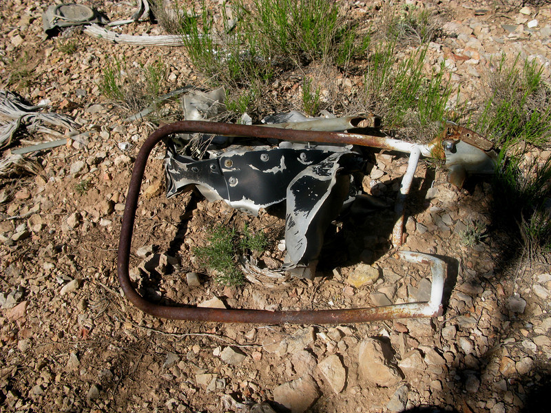 The back portion of a seat frame lies amid other debris at the crash site.