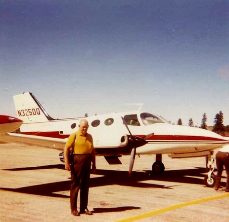 An unidentified air tour passenger poses next to N3250Q during a stop at Grand Canyon National Park Airport in September 1970.