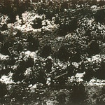 A newspaper aerial photograph of the snow covered crash scene (Las Vegas Review Journal).