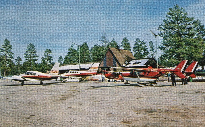 The Scenic Airlines fleet of 1970-1971 consisted of a Piper PA-23 Aztec, Cessna 336 Skymaster, Cessna 205, and two Cessna 402s. Pictured is Cessna 402, N3250Q.<br /> <br /> All shown parked on the ramp in front of the main passenger terminal at the Grand Canyon Airport.
