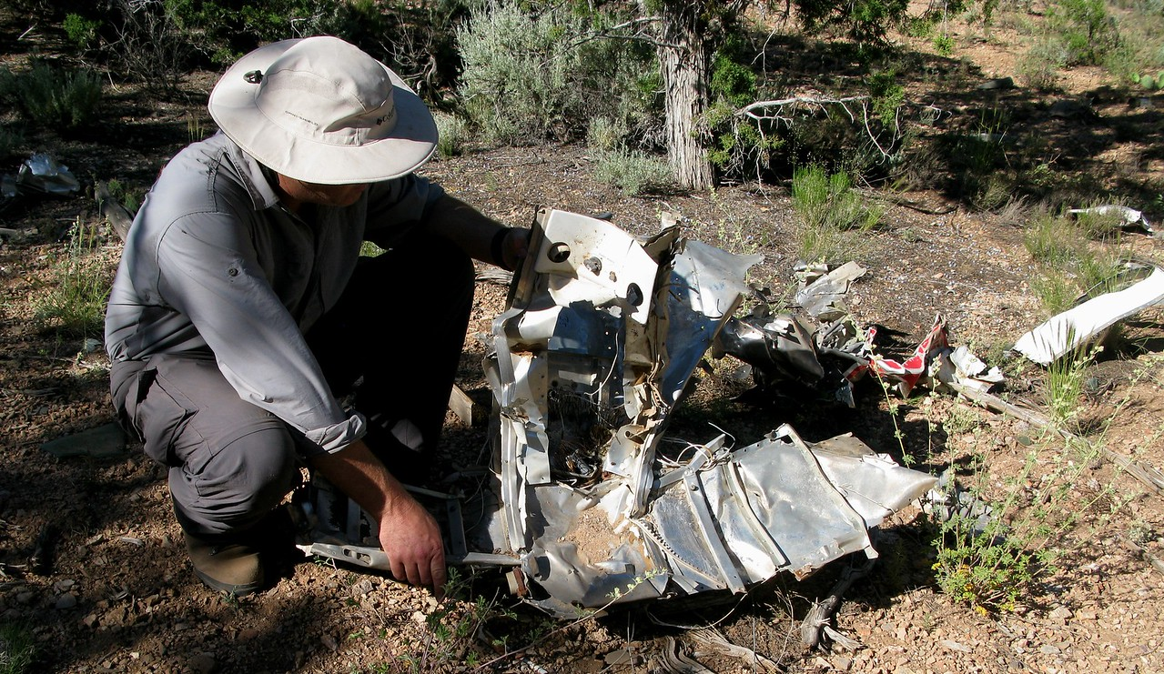 This crumpled forward fuselage fragment was once part of the overhead interior panel found in the cockpit. It not only contained air vents, but also switches and knobs for cabin lighting.