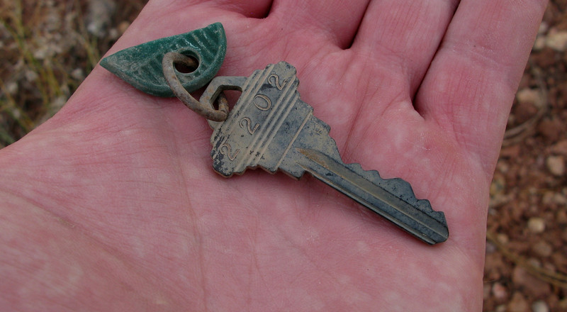 A passenger's hotel room key (Room 2202) was one of the few personal effects located at the site.