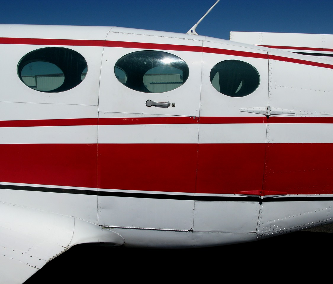 The main cabin door along with the hinged cargo door of the Cessna 402 provided a wide entry for over-sized baggage or cargo.