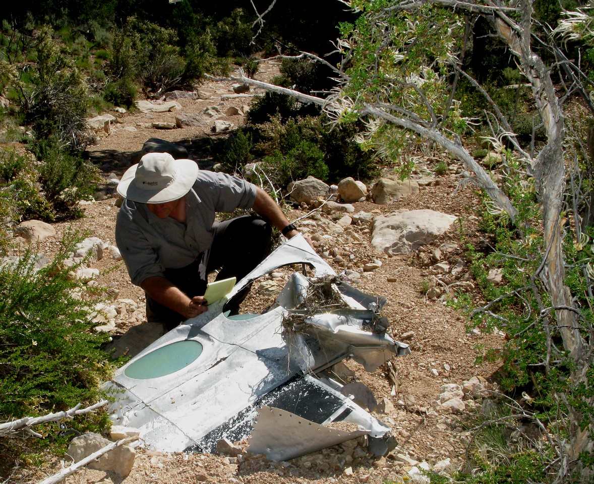 This large fragment of the aircraft's right side fuselage had the only intact window found at the crash site. The fragment was deeply embedded in the sand and debris of the wash.