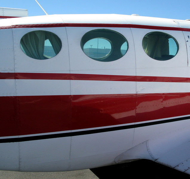 This photo illustrates the original location of the above fragment. The oval windows of the early Cessna 402s suggest the aircraft cabin was pressurized. The passenger cabin however was not.
