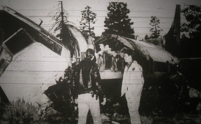 Two Coconino County Sheriff Deputies surveying the crash scene of the Martin. <br /> <br /> The cockpit area sustained a majority of the initial impact damage. As a result, both pilots sustained serious injuries.