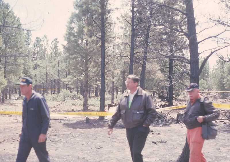 NTSB INVESTIGATION BEGINS - MAY 14, 1991<br /> <br /> The NTSB's accident investigation began the following morning on May 14th. Here we see lead accident investigator Richard Childress (left) walking to the scene with AGC owner Dan Lawler and his father. (1991 LostFlights)