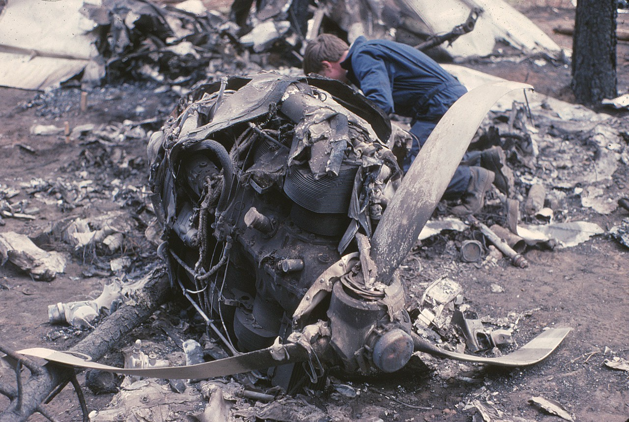 "The NTSB Investigation would later determine the probable cause of the accident was a total loss of engine power due to the catastrophic detonation of the number ""1"" cylinder.<br /> <br /> The loss of power from the engine was immediately suspected by investigators when it was observed that the propeller showed no signs of rotation and minimal chord-wise damage.<br /> <br /> The lack of a suitable and safe landing area was a contributing factor."