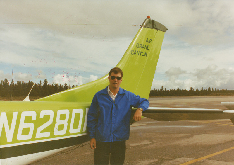 "A picture of me back in 1990 at Grand Canyon Airport with ""Adventure 1"". I still remember the plane as being one of the best in the AGC fleet of Cessna 207s."
