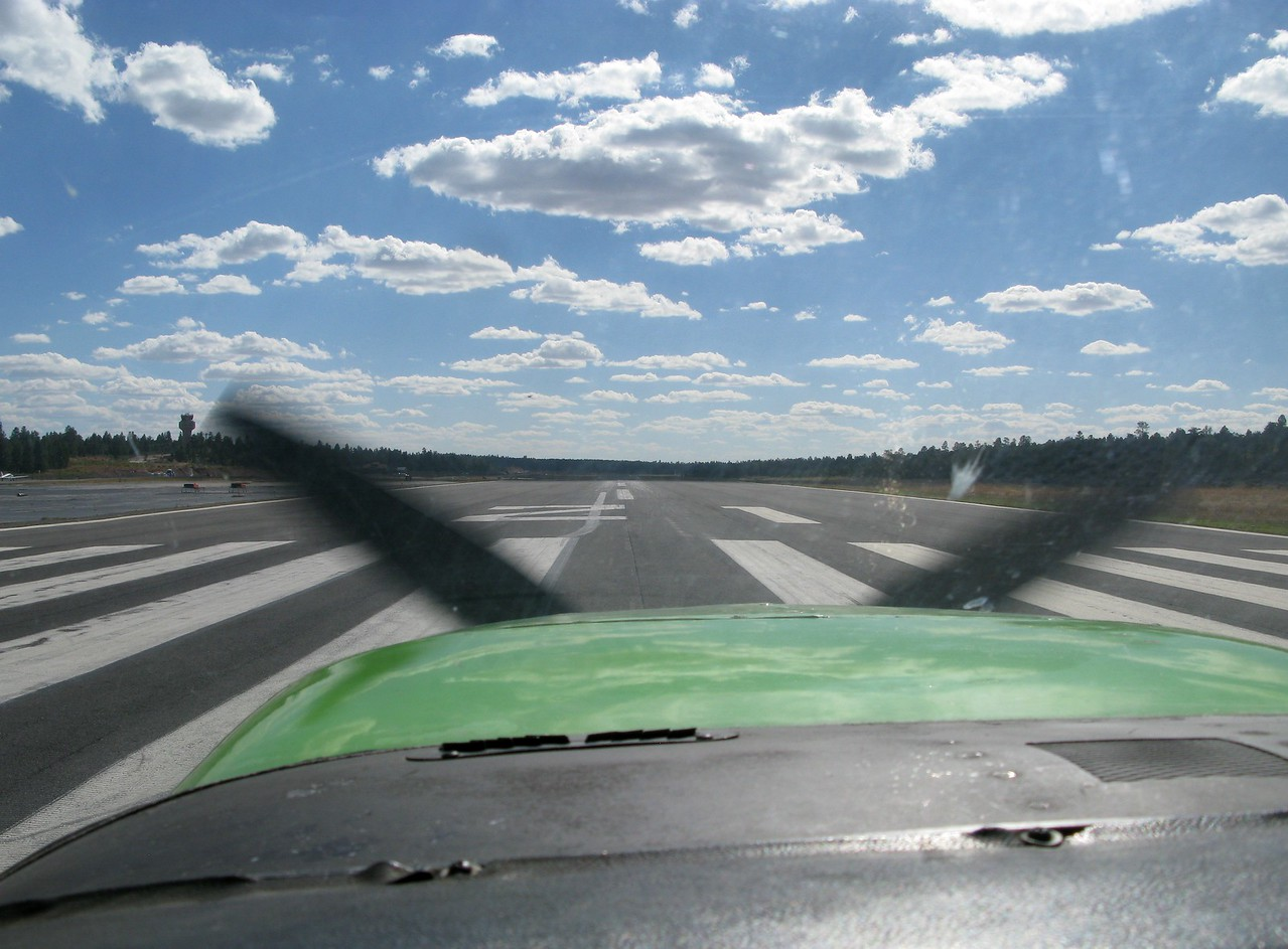 """At 1:12 PM, """"Adventure One"""" was cleared for takeoff on Grand Canyon National Park Airport's Runway 21 with full fuel tanks and every seat occupied."""
