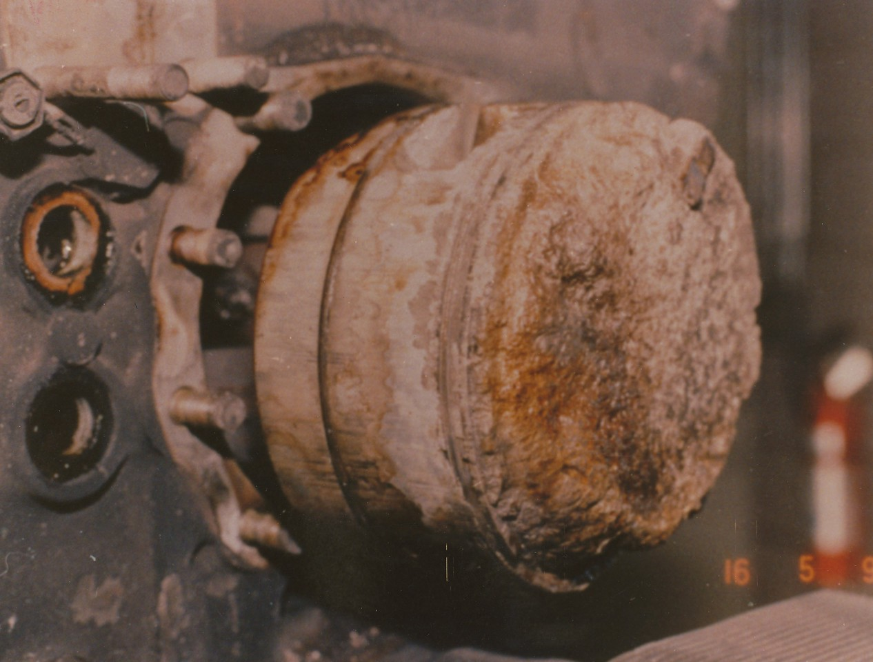 "A close-up photo of the melted piston illustrates the damage caused by the catastrophic detonation.<br /> <br /> In the final seconds of flight the rough running engine eventually seized causing the propeller to stop rotating. A silent, but steep glide to the dense forest below marked the end of ""Adventure One""."