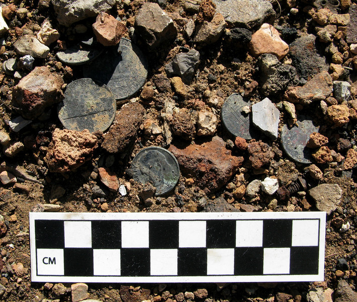 This cluster of coins located in the impact burn area probably came from a passenger's pocket or change purse.