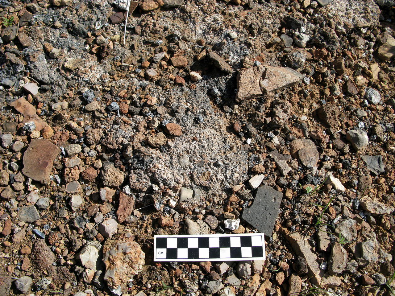 Some evidence of molten aluminum and fire cracked rock was located at the impact site's burn area.