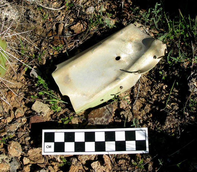 "This fuselage bulkhead or rib fragment from ""Canyon 6"" came from the aft fuselage when the helicopter's main rotor blades tore through the area behind the aft baggage compartment of the Twin Otter.<br /> <br /> As a result of this collision damage, the entire tail section of ""Canyon 6"" separated from the fuselage in-flight causing a complete loss of control."
