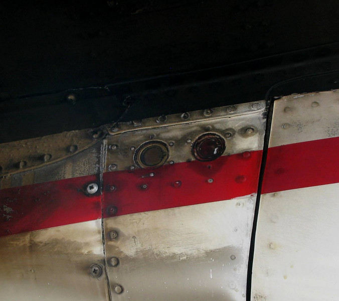 A close-up photo of the fire bottle disc indicators on the aft part of the engine nacelle.