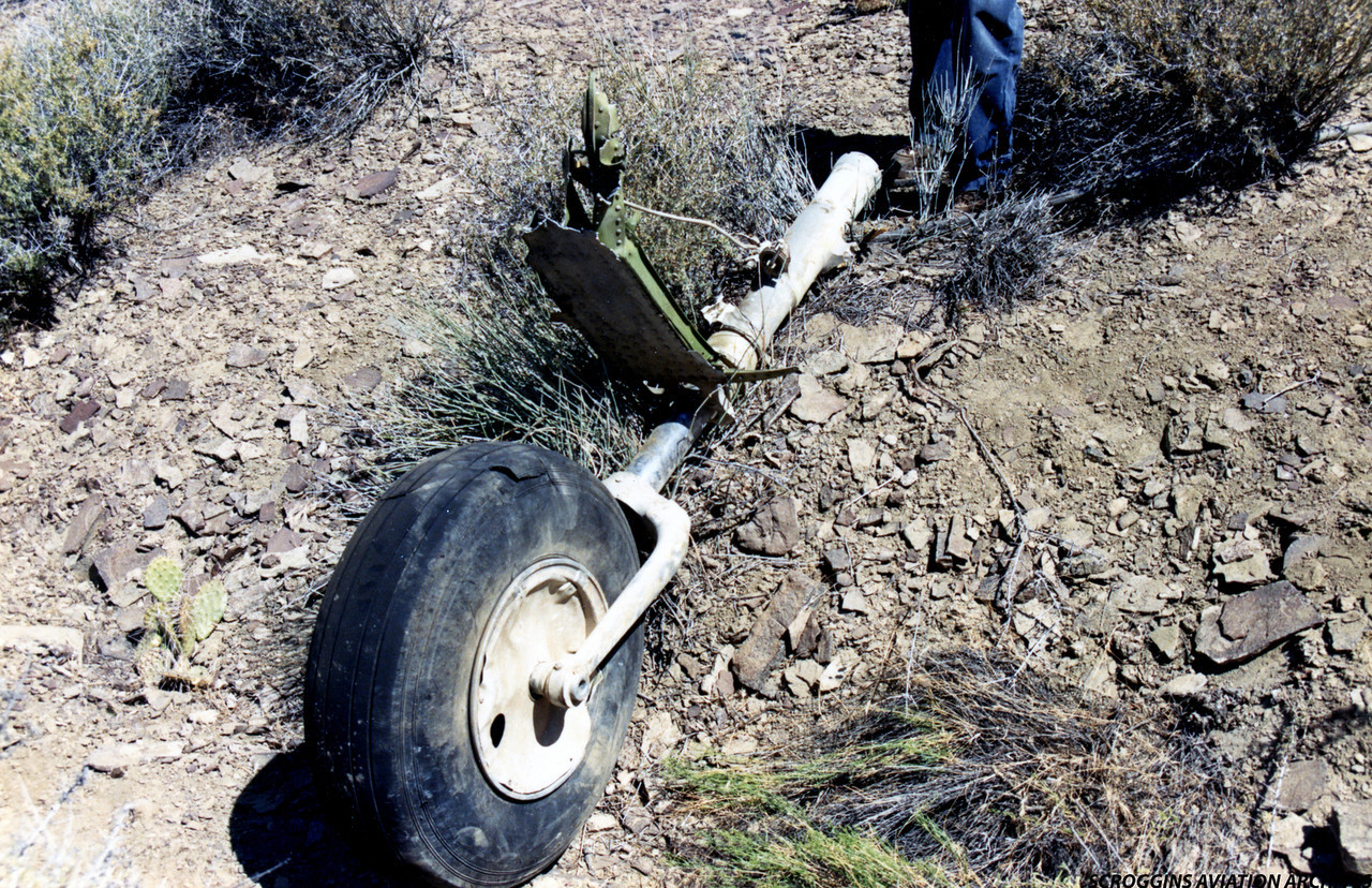 During the mid-air collision sequence, the main rotor blades of the helicopter struck the nose gear and wheel of the Twin Otter, separating it from the aircraft.<br /> <br /> A cut in the crown of the nose gear tire from the helicopter's rotor blade is evident in this photo