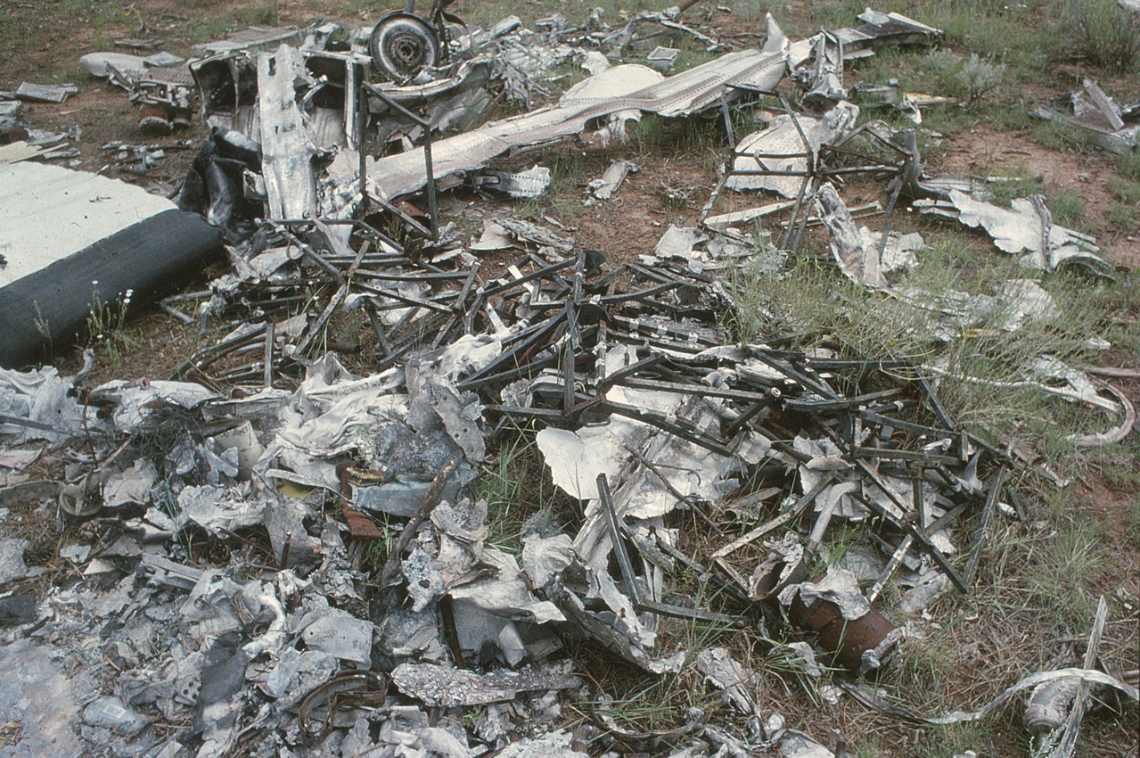 Burned and bent passenger seat frames from the Twin Otter made up some of the debris found at the dump site. <br /> <br /> With the accident investigation long concluded, I received permission from the land owners in 1990 to remove articles from the dump site that I felt were of future historical importance. (1990 LostFlights)