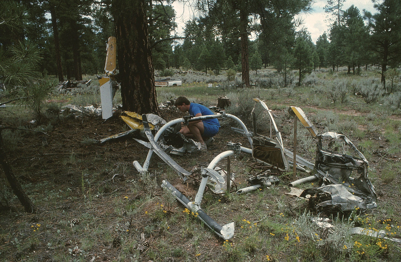 The re-construction was nearly complete with the tail fin, tail boom, landing skid and doors. <br /> <br /> The cabin was mostly consumed in the post crash fire and many of the key impact pieces had been removed during the NTSB investigation. (1990 LostFlights)