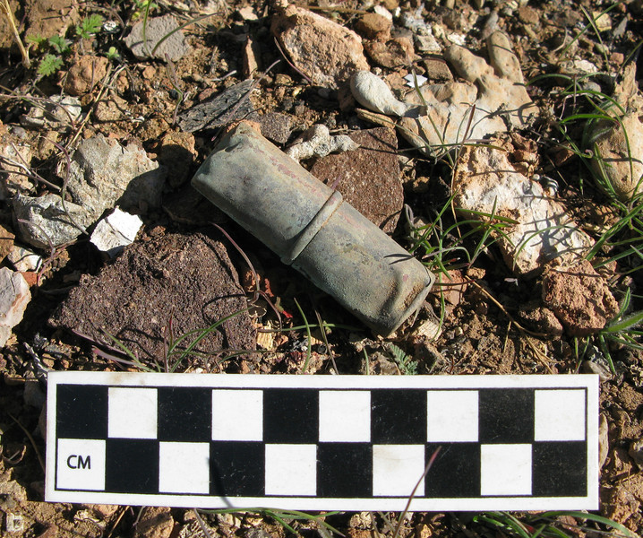 A sealed and closed cosmetic lipstick container was found outside of the burn area.