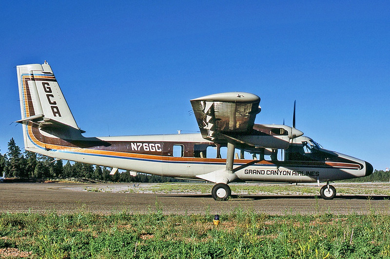 """By 1983, the aircraft was re-registered as """"N76GC"""" by Grand Canyon Airlines and was operated with the radio call sign """"Canyon 6"""". <br /> <br /> The big window modification is clearly visible as well as its new distinctive terrain blending earth-tone paint scheme."""