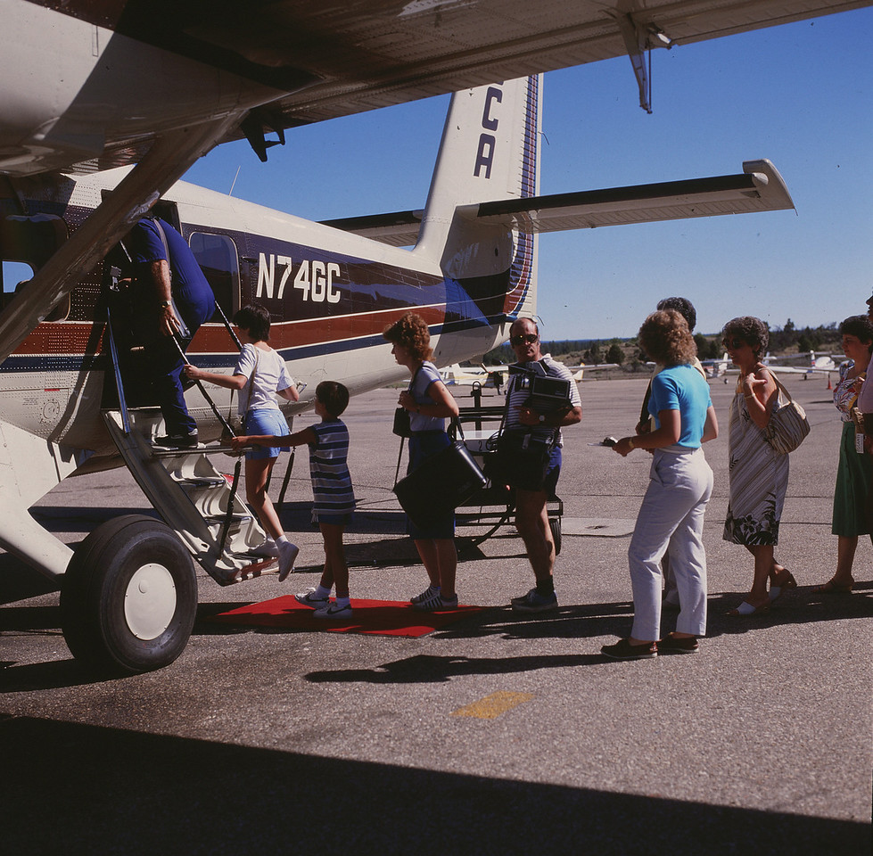 """GRAND CANYON - JUNE 18, 1986 - 8:55 AM<br /> <br /> Passengers boarding Vistaliner """"Canyon 4"""" for a morning air tour of the Grand Canyon. Both N74GC and N76GC utilized a drop down airstair door to board passengers. <br /> <br /> On the morning of June 18th, both """"Canyon 6"""" and """"Canyon 4"""" were flying the popular """"Canyon Highlights Tour"""" about ten minutes apart. (LostFlights Photo)"""