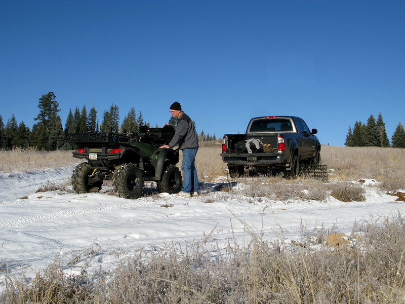 2nd. ATTEMPT - NOVEMBER 2010<br /> <br /> The morning of my second attempt to reach the crash sites, the temperature at the Point Sublime Meadow was in the low 20s and the ground was covered with freshly fallen snow.<br /> <br /> In this photo, I am making final preparations on the ATV for the 13 mile drive to the parking area and the start of my hike into the canyon.
