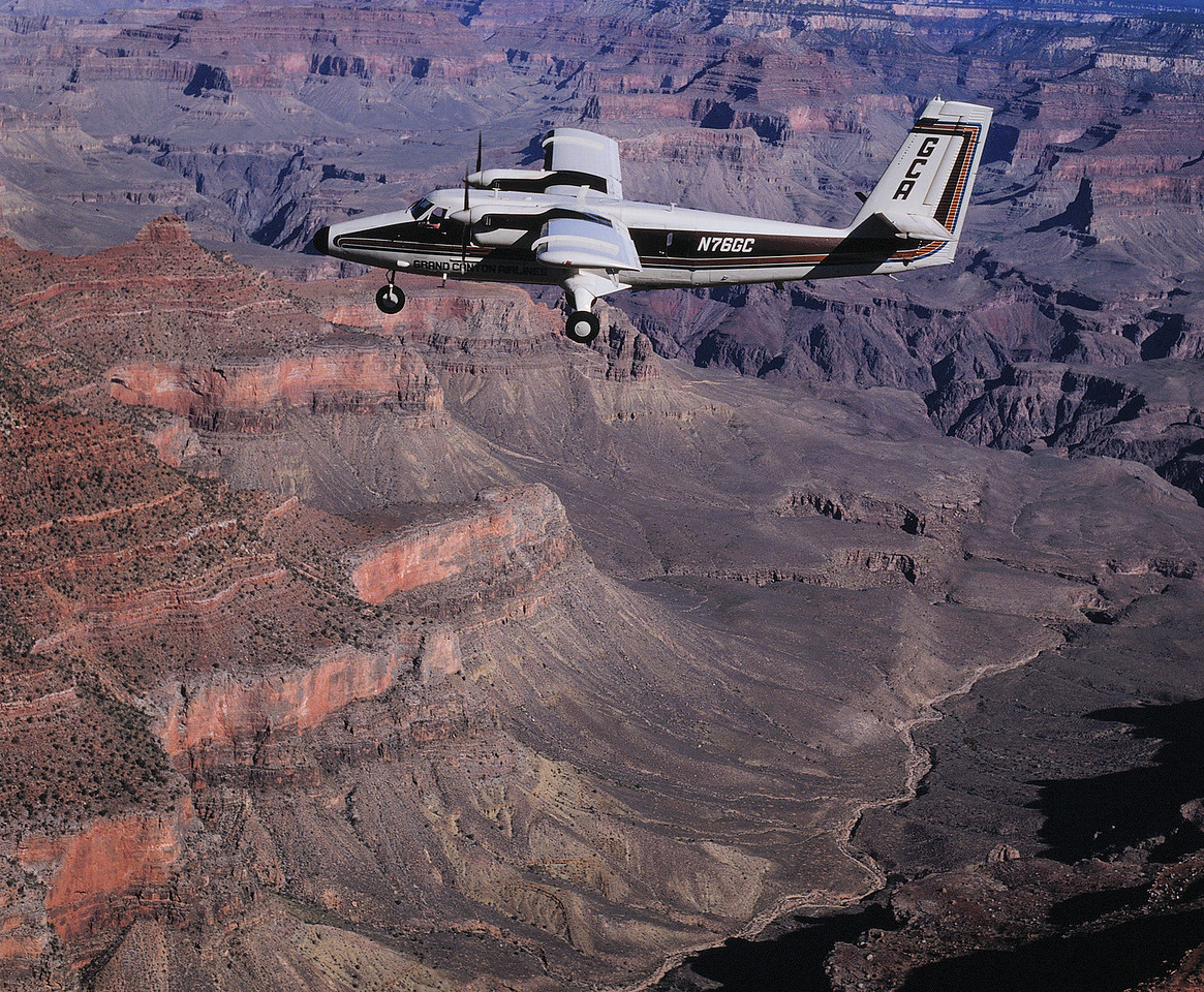 """The GCA Vistaliner, operating under call sign """"Canyon 6"""" was approaching Crystal Rapids from the west as the Helitech Bell 206B, call sign """"Tech 2"""" was flying southbound near Mencius Temple. <br /> <br /> A vertical separation of 500 feet was supposed to be maintained by both aircraft per the informal agreement with """"Tech 2"""" at 6,500 feet and """"Canyon 6"""" at 7,000 feet. A recent change in helicopter tour routes strongly encouraged by the National Park Service and based primarily on the reduction of noise pollution was implemented two weeks prior. <br /> <br /> The change in the helicopter route brought both fixed-wing and helicopter tour traffic into potential conflict. (2008 LostFlights)"""