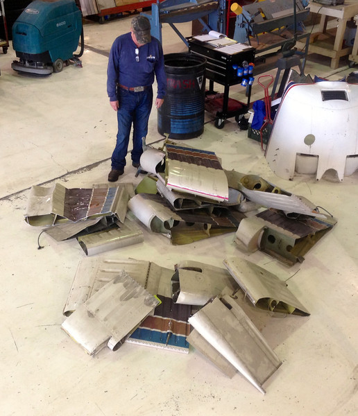 "In the end, it was decided to scrap the parts. Jeff Stevenson, seen here in this photo was not disappointed to see these ""reminders"" hauled away. <br /> <br /> Mr. Stevenson, worked for Helitech in 1986. He knew both of the ""Canyon 6"" pilots and Helitech pilot John Thybony. Jeff was working on that fateful day in 1986 and helped launch ""Tech 2"" on it's last flight."