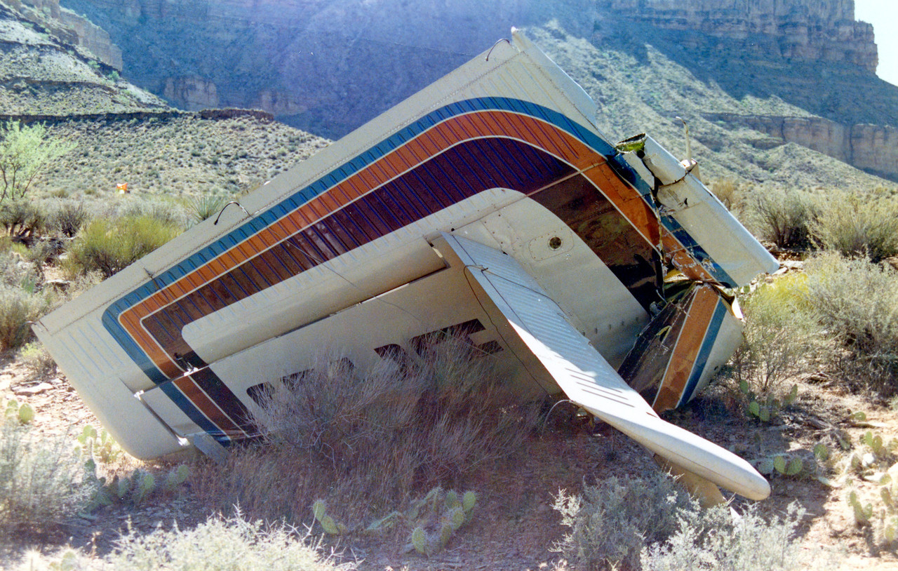 The severed tail section of the Twin Otter came down inverted on the plateau with minimal damage to the rudder, elevators, and horizontal stabilizer.
