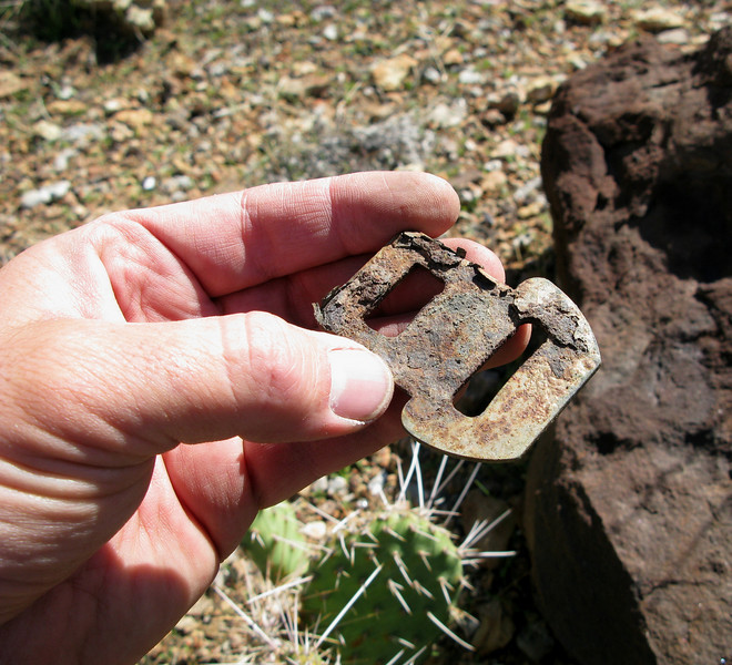 "This burned passenger seat belt latch was a somber reminder of the 18 passengers that perished on ""Canyon 6""."