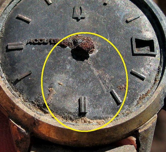 "I studied this watch extensively at the crash site and even though it was burned and the timepiece hands missing, the burned ""shadowed"" imprint of the minute hand position was still visible on the watch dial. <br /> <br /> The watch was indicating :26 minutes past the hour. The shorter hour hand position was not as obvious, but was probably positioned near the ""Accutron"" name due to the build-up of deposits in the 9:00 position."