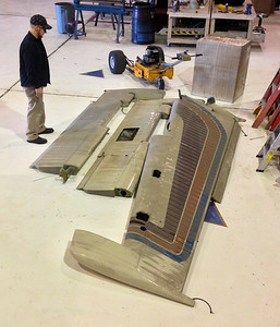 During August 2013 and over 27 years after the disaster, the rudder and elevator flight control assemblies were brought down from the attic to the floor of the hangar.  For several days maintenance personnel contemplated what to do with the components.