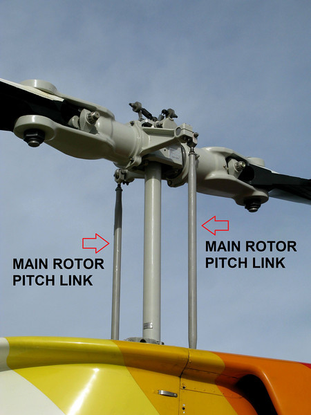 """This photograph of a Bell 206 Jet Ranger main rotor assembly illustrates the location of the two main rotor pitch links. <br /> <br /> This entire assembly and the main rotor mast in between the two links broke apart and sheared from """"Tech 2"""" after the collision."""