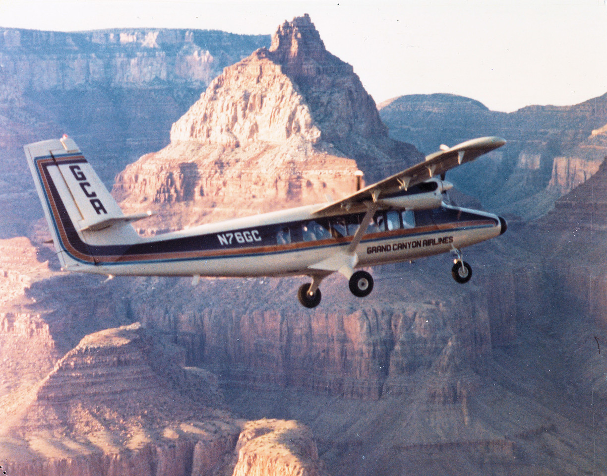 "N76GC (s/n: 248) - DHC-6-300 ""VISTALINER""<br /> <br /> deHavilland Twin Otter ""N76GC"" seen passing 7,400 foot Vishnu Temple was purchased in May 1982 and after modification work was delivered to Grand Canyon Airlines during February 1983. This was the first aircraft of it's type to be operated by the airline.<br /> <br /> Dubbed a ""Vistaliner"", the deHavilland DHC-6-300 Twin Otter was a 19 passenger turbo-prop specifically designed for the air tour industry. The modified aircraft featured large passenger windows, air conditioning, and a quiet insulated cabin. The verbal tour was provided to the passengers over headphones and was narrated by the non-flying pilot. (Photo courtesy of LostFlights)"